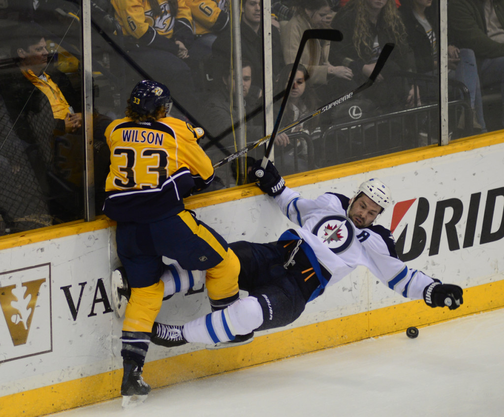 THe Predators Colin Wilson collides with The Jets Mark Stuart. Photo by Mike Strasinger