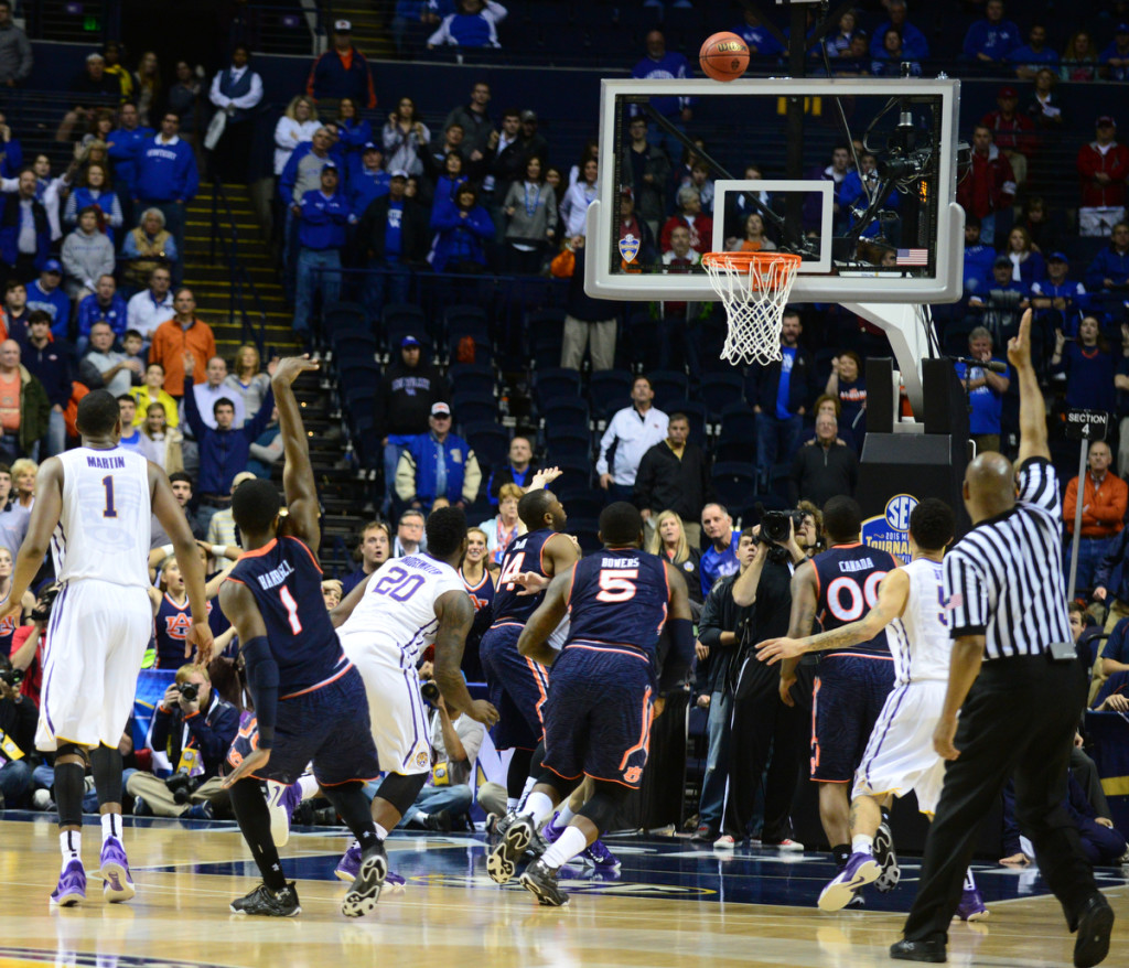 Auburn's KT Harrell shoots a 3 pointer to force OT vs LSU. Photos by Mike Strasinger