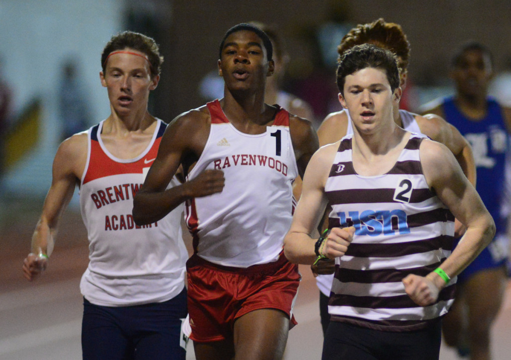 Havenwood's Matt Rainey (center) runs for a new meet record in the 800. Photo by Mike Strasinger