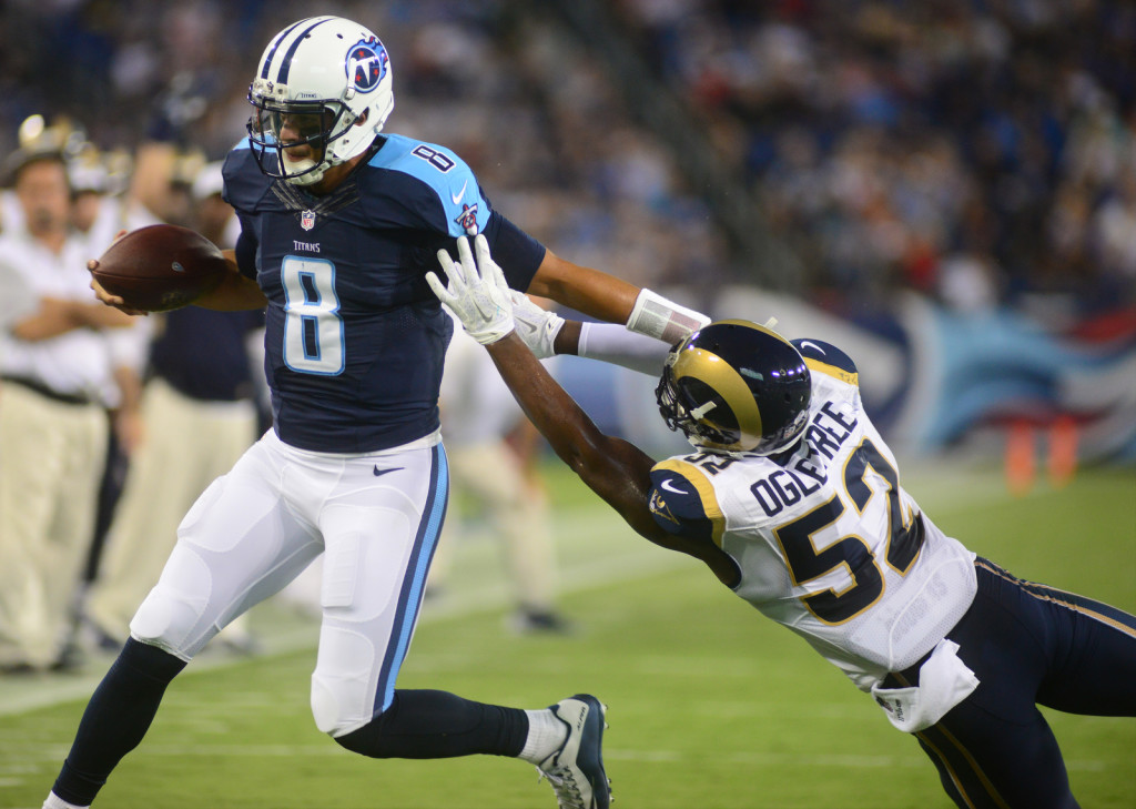 The Titans Marcus Mariota runs against the St. Louis Rams - Photos by Mike Strasinger