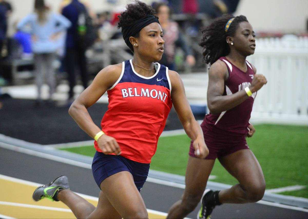 Belmont's LaCarol Baynes runs in the 200 meter dash at the Commodore Invitational. Photos by Mike Strasinger
