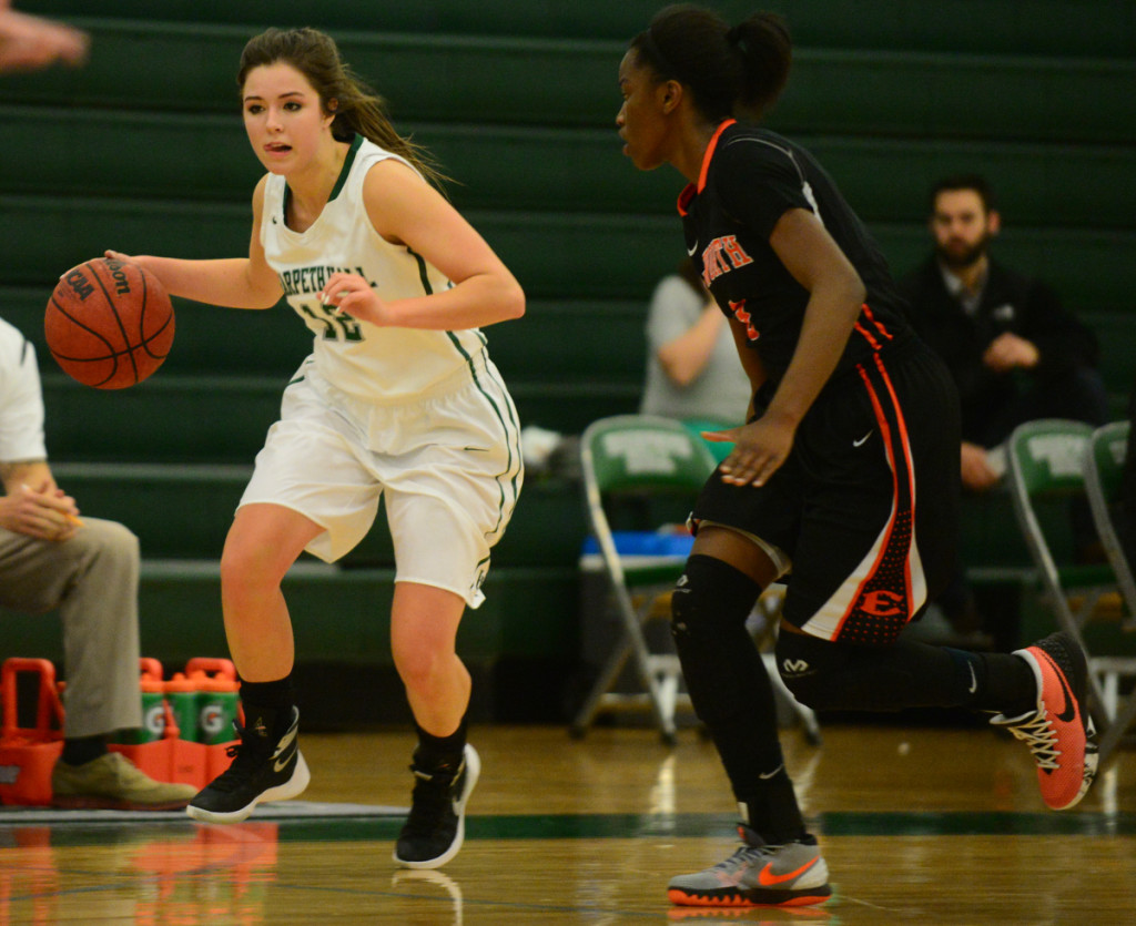 Harpeth Hall's Shelby Nutter drives past Ensworth's Jordyn Cambridge - photo by Mike Strasinger