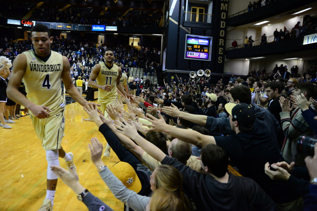 Vanderbilt's Wade Baldwin IV (4) and Jeff Roberson (11) celebrate with the Commodore fans after beating #8 Texas A&M 77-60. Photos by Mike Strasinger