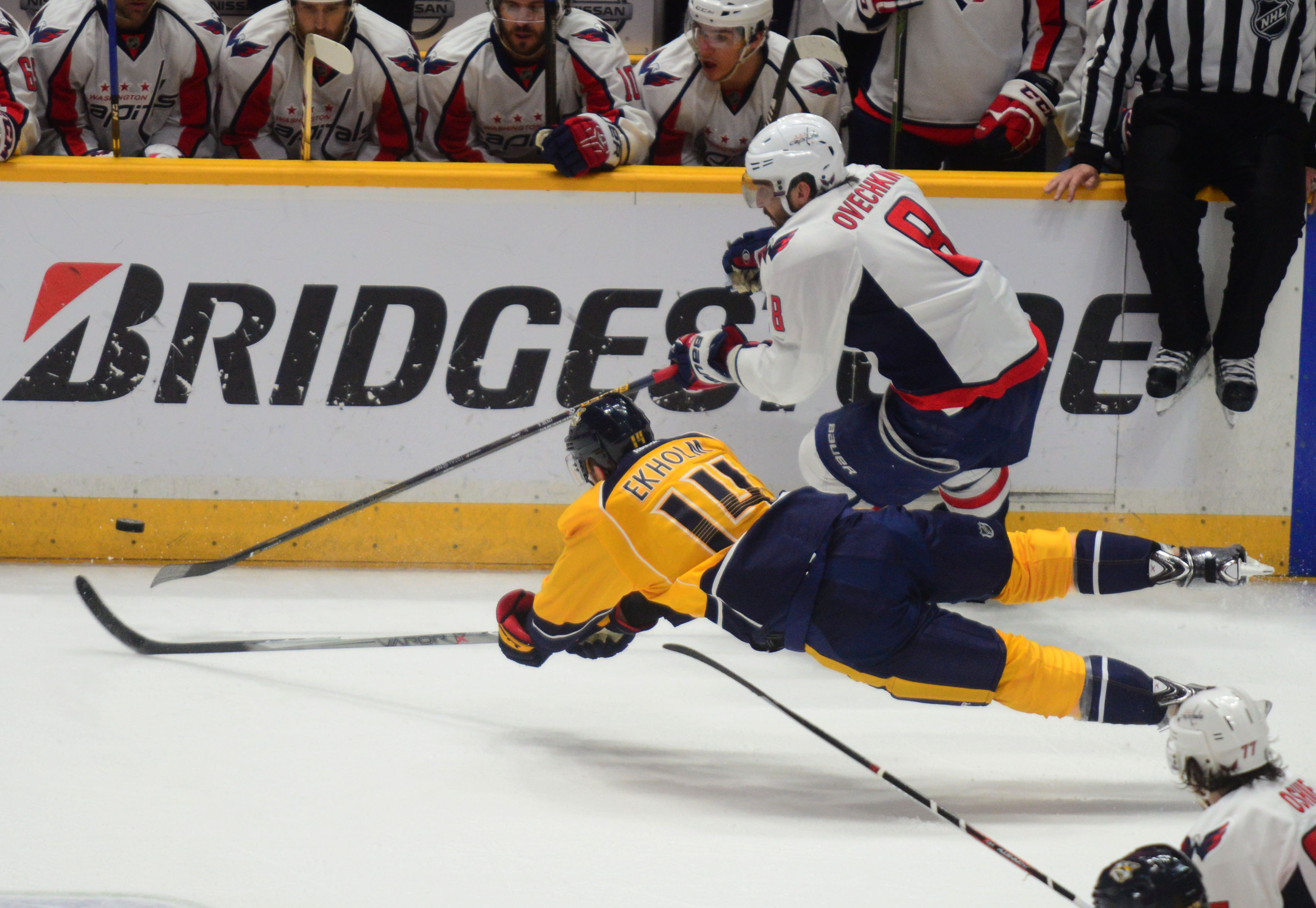 The Predators Mattias Ekholm goes after the Capitals Alex Ovechkin - Photo by Mike Strasinger