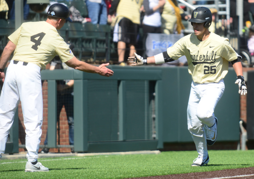 Vanderbilt's Karl Ellison is congratulated by coach Tim Corbin after Ellison hit a 1st inning home run. - Photo by Mike Strasinger