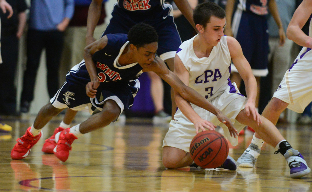 Whites Creek guard Jonathan Richardson (left) forced a turnover against CPA's Michael Mayernick late in the Cobras' 45-41 overtime win Monday night. Photo by Mike Strasinger