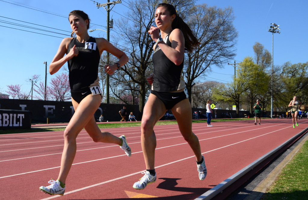 Vanderbilt's Carmen Carlos. left and Vanessa Valentine run in the 3K. Carlos set a school record and Valentine ran the 3rd best time ever for Vandy - Photos by Mike Strasinger