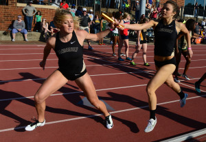 Vandy's Skyler Carpenter takes the baton form Lydia Witty in the 4X 400 relay.