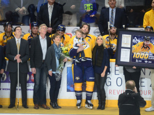 Mike Fisher and family watch the jumbotron during pre-game ceremony commemorating Fisher's 1,000th NHL game