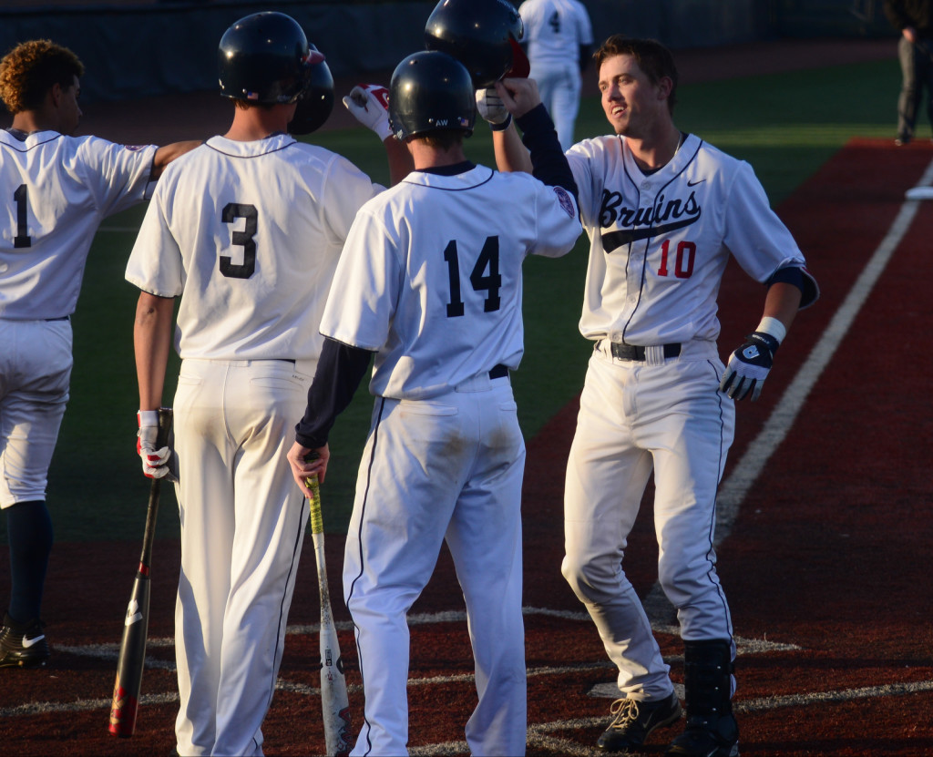 Belmont's Clay Payne (10) is welcomed home after a 3-run shot against Lipscomb. Payne had 5 RBI on the day.