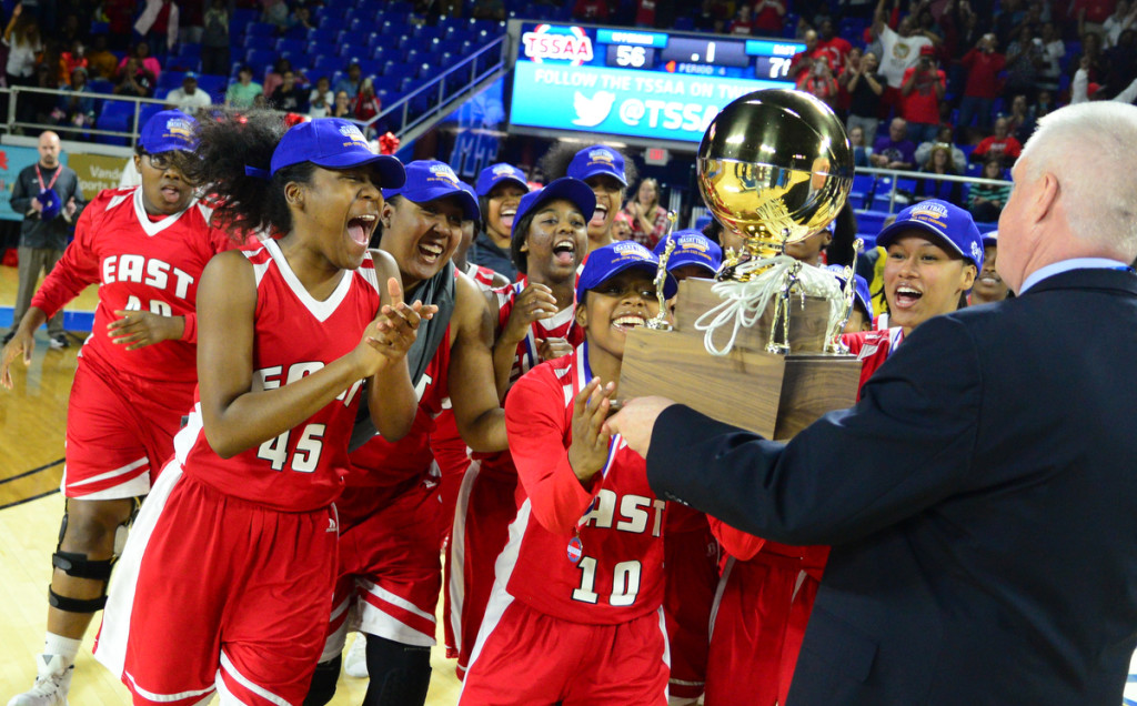 The East Nashville Lady Eagles collect their championship trophy - photos by Mike Strasinger