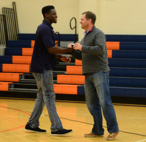 UT bound Daniel Bituli receives his ring from Coach Brothers.