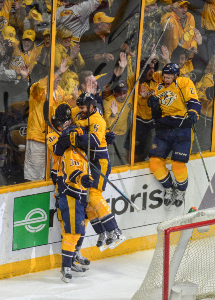 The Predators celebrate after Viktor Arvidsson scored in OT to win Game 6 over the Sharks, Photos by Mike Strasinger
