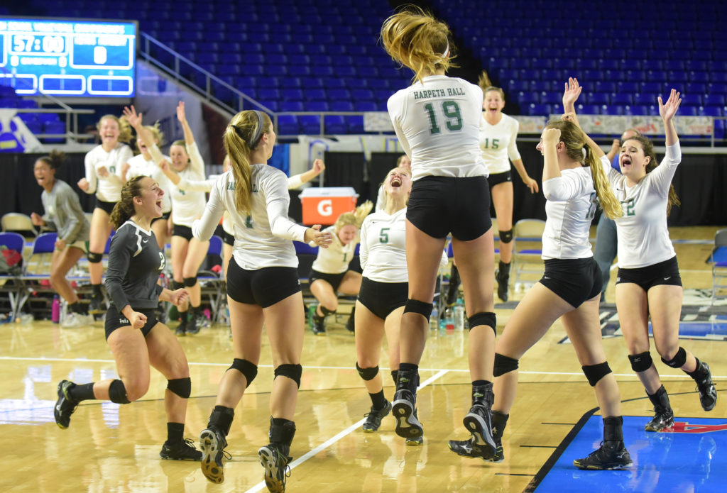 Harpeth Hall celebrates their win over Father Ryan in 5 sets. Photos by Mike Strasinger